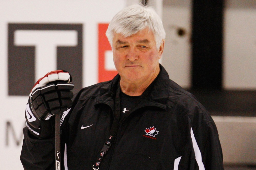 Canada's head coach Quinn watches his team's practice at the 2009 IIHF U20 World Junior Hockey Championships in Ottawa in this file photo